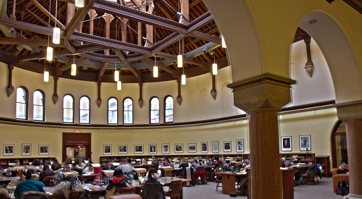 Students seated in the Gerstein Library reading room